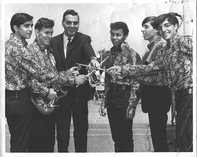The Younger Generation at the Battle of Bands contest at the Mid Island Shopping Plaza, Hicksville, Long Island, 1967. Left to right, Johnny Rosolino (lead vocals), Jim Dean (guitar, vocals), Ralph Marino (lawyer from Oyster Bay, future New York State senator), Louis Mayhew (lead vocals), Alan Galasso (guitar), Roland Donisi (drums)